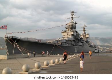 "NOVOROSSIYSK, RUSSIA - August 07, 2016:  Evening view of old navy ship-museum cruiser ""Mikhail Kutuzov"" moored at pier of port of Novorossiysk"
