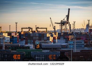 Novorossiysk, Russia - Circa February 2019: Freight transportation sea port for import and export goods, cargo containers with cranes, industrial business shipping and logistic terminal