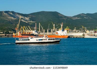 NOVOROSSIYSK, RUSSIA - JULY 3, 2018: A pleasure boat  in Tsemes bay in the  port of Novorossiysk.