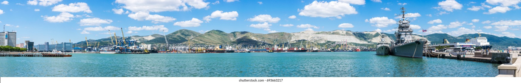 "NOVOROSSIYSK, RUSSIA - JULY 5, 2017: Panoramic view of Tsemes bay, port and sea-front in Novorossiysk, Russia. The inscription on the pier is ""Boat trips"""