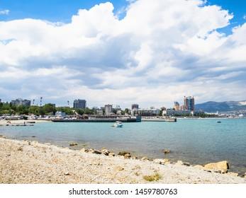 NOVOROSSIYSK, RUSSIA - JULY 7, 2019: view of waterfront along Admiral Serebryakov Embankment in Novorossiysk. Novorossiysk is city in Krasnodar Krai, Russia, it is main country's port on Black Sea