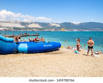 NOVOROSSIYSK, RUSSIA - JULY 7, 2019: boat and people on beach along Admiral Serebryakov Embankment in Novorossiysk. Novorossiysk is city in Krasnodar Krai, Russia, it is country's port on Black Sea