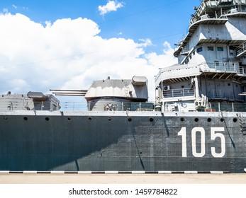 NOVOROSSIYSK, RUSSIA - JULY 7, 2019: memorial ship cruiser Mikhail Kutuzov near pier in sea port in Novorossiysk. Novorossiysk is city in Krasnodar Krai, Russia, it is main country's port on Black Sea
