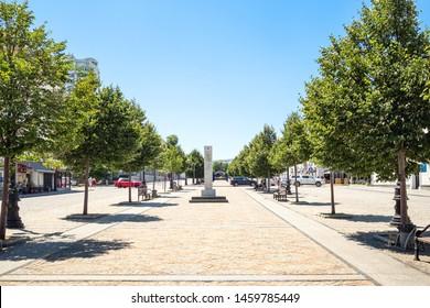 NOVOROSSIYSK, RUSSIA - JULY 7, 2019: view of pedestrian part of street of the Novorossiysk Republic with obelisk. Novorossiysk is city in Krasnodar Krai, Russia, it is main country's port on Black Sea