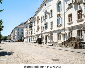 NOVOROSSIYSK, RUSSIA - JULY 7, 2019: old apartment houses on street of the Novorossiysk Republic. Novorossiysk is city in Krasnodar Krai, Russia, it is main country's port on Black Sea