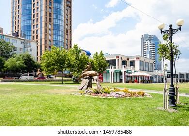 NOVOROSSIYSK, RUSSIA - JULY 7, 2019: lawn with statue Girl on Dolphin on Admiral Serebryakov Embankment . Novorossiysk is city in Krasnodar Krai, Russia, it is main country's port on Black Sea