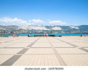 NOVOROSSIYSK, RUSSIA - JULY 7, 2019: tourists on Forum Square of Admiral Serebryakov Embankment in Novorossiysk. Novorossiysk is city in Krasnodar Krai, Russia, it is main country's port on Black Sea