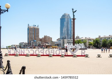 NOVOROSSIYSK, RUSSIA - JULY 7, 2019: tourists on Forum Square on Admiral Serebryakov Embankment in sea port of Novorossiysk city . Novorossiysk is main country's port on Black Sea