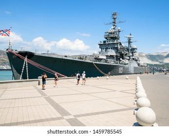 NOVOROSSIYSK, RUSSIA - JULY 7, 2019: tourists near museum ship cruiser Mikhail Kutuzov in Novorossiysk. Novorossiysk is city in Krasnodar Krai, Russia, it is main country's port on Black Sea