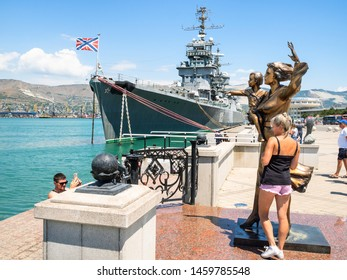 NOVOROSSIYSK, RUSSIA - JULY 7, 2019: tourists near Monument to the Sailors Wives (Mother with Child) in Novorossiysk. Novorossiysk is city in Krasnodar Krai, Russia, it is country's port on Black Sea