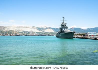 NOVOROSSIYSK, RUSSIA - JULY 7, 2019: Sea port and museum ship cruiser Mikhail Kutuzov in Novorossiysk. Novorossiysk is city in Krasnodar Krai, Russia, it is main country's port on Black Sea