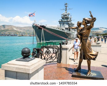 NOVOROSSIYSK, RUSSIA - JULY 7, 2019: people near Monument to the Sailor's Wife (Mother with Child) in Novorossiysk. Novorossiysk is city in Krasnodar Krai, Russia, it is country's port on Black Sea