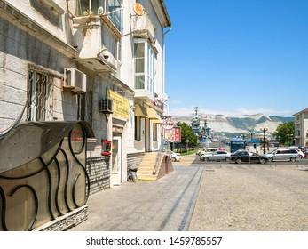 NOVOROSSIYSK, RUSSIA - JULY 7, 2019: view of sea port from street of the Novorossiysk Republic. Novorossiysk is city in Krasnodar Krai, Russia, it is main country's port on Black Sea