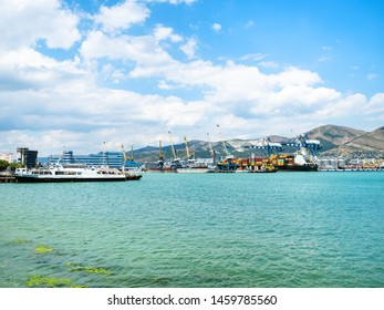 NOVOROSSIYSK, RUSSIA - JULY 7, 2019: ships in sea port in Novorossiysk. Novorossiysk is city in Krasnodar Krai, Russia, it is main country's port on Black Sea