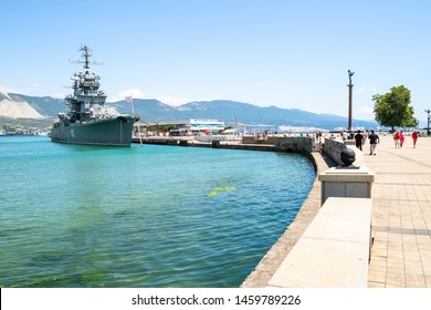 NOVOROSSIYSK, RUSSIA - JULY 7, 2019: people walk to museum ship cruiser Mikhail Kutuzov in sea port in Novorossiysk. Novorossiysk is city in Krasnodar Krai, Russia, it is country's port on Black Sea