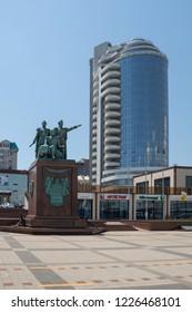 Novorossiysk, Russia - July 9: Memorial and multistoried building in Novorossiysk on July 9, 2018 in Novorossiysk, Russia.