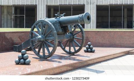 Novorossiysk, Russia - July 9: Old gun and cannonballs in Novorossiysk on July 9, 2018 in Novorossiysk, Russia.