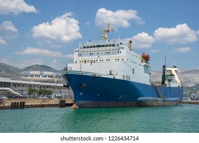 Novorossiysk, Russia - July 9: Vessel moorage on the berth in port of Novorossiysk on July 9, 2018 in Novorossiysk, Russia.