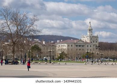Novorossiysk, Russia - March 25: Phorumnaya square and residential house in Novorossiysk on March 25, 2019 in Novorossiysk, Russia.