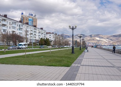 Novorossiysk, Russia - March 25: Seafront against the background of mountains in Novorossiysk on March 25, 2019 in Novorossiysk, Russia.