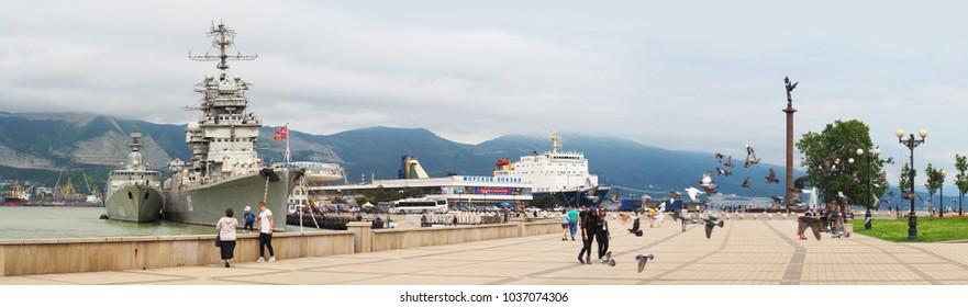 Novorossiysk, Russia - May, 2017: Life of the city. People in the city, tourism. Panorama of ebankment of Admiral Serebryakov, forum square. Marine Station. Ship-museum cruiser Mikhail Kutuzov