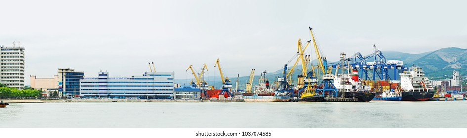 Novorossiysk, Russia - May, 2017: Panorama of Novorossiysk commercial sea port.  Seaport with cranes. Tsemesskaya or Novorossiyskaya bay of the Black Sea. Transport center