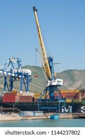 Novorossiysk, Russia - may 3, 2018: Portal port crane in the port of Novorossiysk, Black Sea, Russia