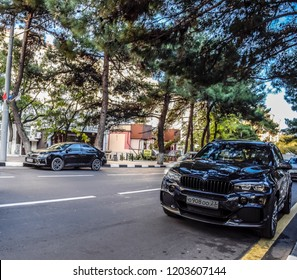 Novorossiysk, Russia - September 29, 2018: Car Toyota Camry and BMW X3 parked at the edge of the roadway.