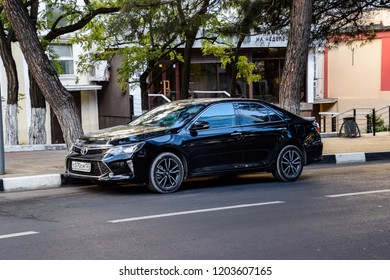 Novorossiysk, Russia - September 29, 2018: Car Toyota Camry parked at the edge of the roadway.