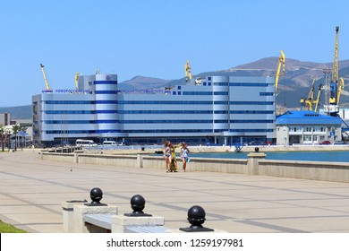 Novorossiysk, RUSSIA-AUGUST 10, 2015: Girls in the background of the commercial port administration building