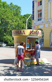 Novorossiysk, RUSSIA-AUGUST 10, 2015: woman buys Russian national drink kvass on a hot day