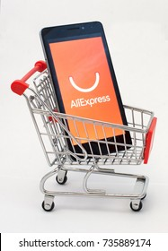 Novorossiysk, Russian Federation - Oct 15, 2017: - A smartphone with an aliexpress app in a shopping cart. The concept. Online shopping via smartphone application