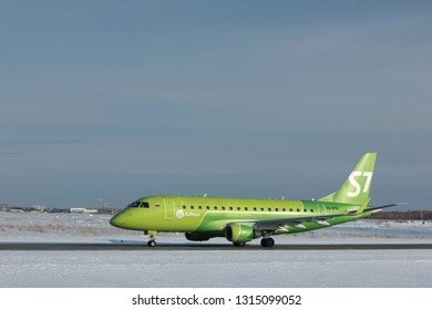NOVOSIBIRSK - FEB. 17, 2019: Embraer ERJ-170 of S7 airlines taxiing to the runway at Novosibirsk Tolmachevo Airport.