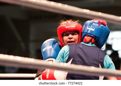 NOVOSIBIRSK - MAY 15: Russian Championship in women's boxing. The battle between the Shvetz(red) and Evdokimova(blue)  on May 15, 2011, Novosibirsk Russia