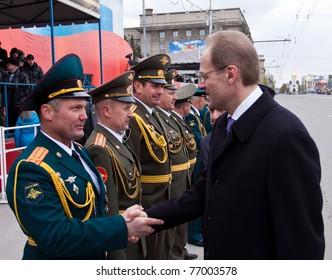 NOVOSIBIRSK - MAY 9: Vasiliy Yurtchenko governor of Novosibirsk region, congratulates the commander on the parade dedicated victory in Great Patriotic War on May 9, 2011, Novosibirsk Russia