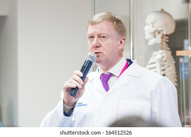NOVOSIBIRSK - November 13: Anatoly Chubais - head of RUSNANO gives interview at the opening of a plant for production of ceramics. It is opening its new plant November 13, 2013, Novosibirsk, Russia