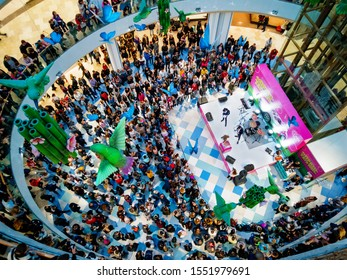"""Novosibirsk, Novosibirsk region / Russia - October, 26 2019: many spectators watch the performance of a musical group on stage at a promo event in the shopping center """"Aura"""""""