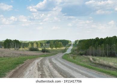 Novosibirsk Region, Russian Federation, 22.05.2020 Country road in a village in the Novosibirsk Region