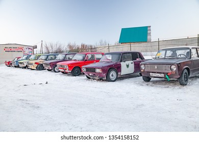 Novosibirsk, Russia - 02.02.2019: Old Russian cars Lada 2101 and 2104 prepared for racing standing on parking and waiting for  drifting and moving in a skidder in a turn on a specially cleared track