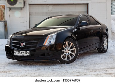 Novosibirsk, Russia - 03.10.2019: Front view of Cadillac CTS in black color after cleaning before sale in a winter day and snow background on parking