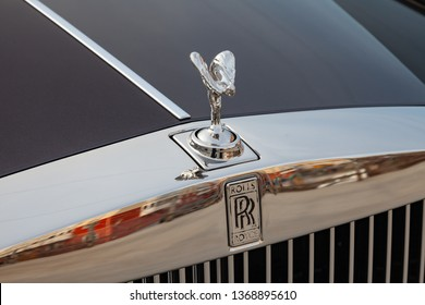 Novosibirsk, Russia - 04.11.2019: Front view of emblem Spirit of Ecstasy of new a very expensive Rolls Royce Phantom car, a long black limousine, model outdoors on parking