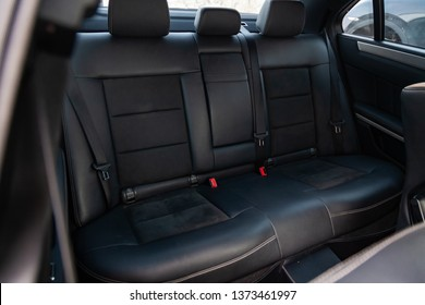 Novosibirsk, Russia - 04.12.2019: The interior of the car Mercedes Benz E-class E250 with a view of the rear seats with light gray trim