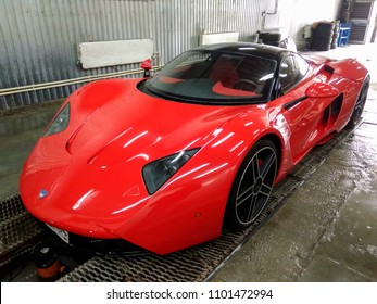 Novosibirsk, Russia - 05.28.2018: Marussia b1 front view. Photography of a Russian supercar in the garage