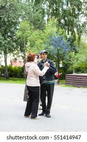 Novosibirsk, Russia - 07 August 2016: Unidentified elderly men and women dancing in a Park in Novosibirsk is 07 August 2016.