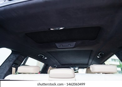 Novosibirsk, Russia - 07.20.2019: View to the white and brown interior of BMW X7 M Performance with black soft leather roof, sunroof and lamp after cleaning before sale on parking