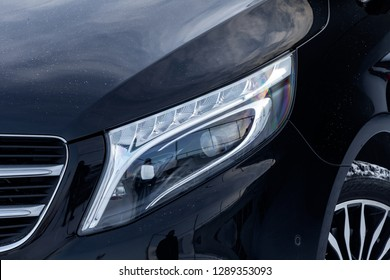 Novosibirsk, Russia - 08.01.2018: Front view of new a expensive Mercedes Benz V-class minivan led headlamp, a long black limousine model