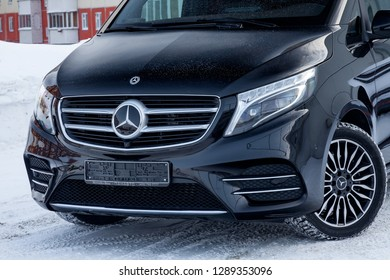 Novosibirsk, Russia - 08.01.2018: Front view of new a expensive Mercedes Benz V-class minivan bumper and hood of a car, a long black limousine, model outdoors, prepared for sale on a sunny winter day