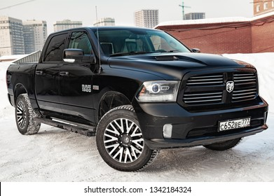 Novosibirsk, Russia - 12.01.2018: Black Dodge Ram with an engine of 5.7 liters front view on the car parking with snow background.