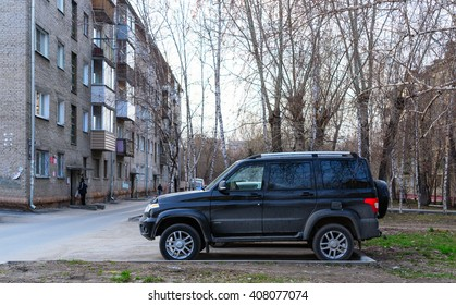 """Novosibirsk, Russia - 16 April 2016: The car """"UAZ Patriot"""" stands in the Parking lot of an apartment house in Novosibirsk from April 16, 2016."""