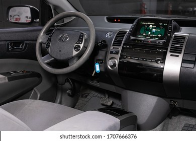 Novosibirsk/ Russia – April 02, 2020 :  Toyota Prius,  car Interior - steering wheel, shift lever, player and dashboard